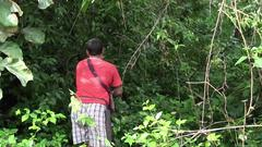 Collecting Yangkali Seeds from the Forest